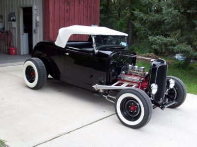 Photo of vintage convertible car with exposed engine
