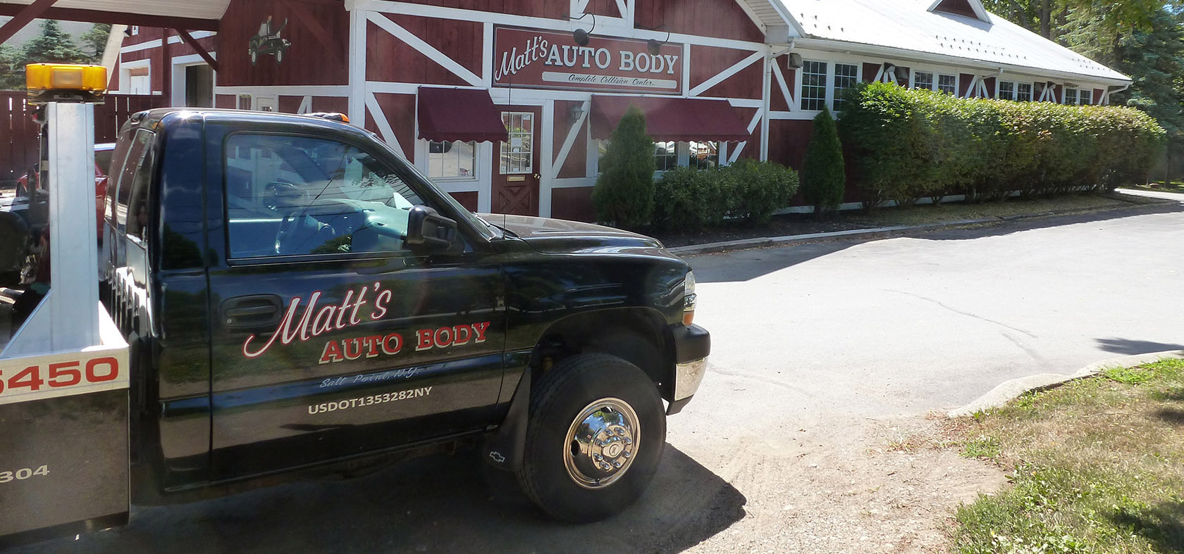 photo of Matt's Auto Body shop and tow truck